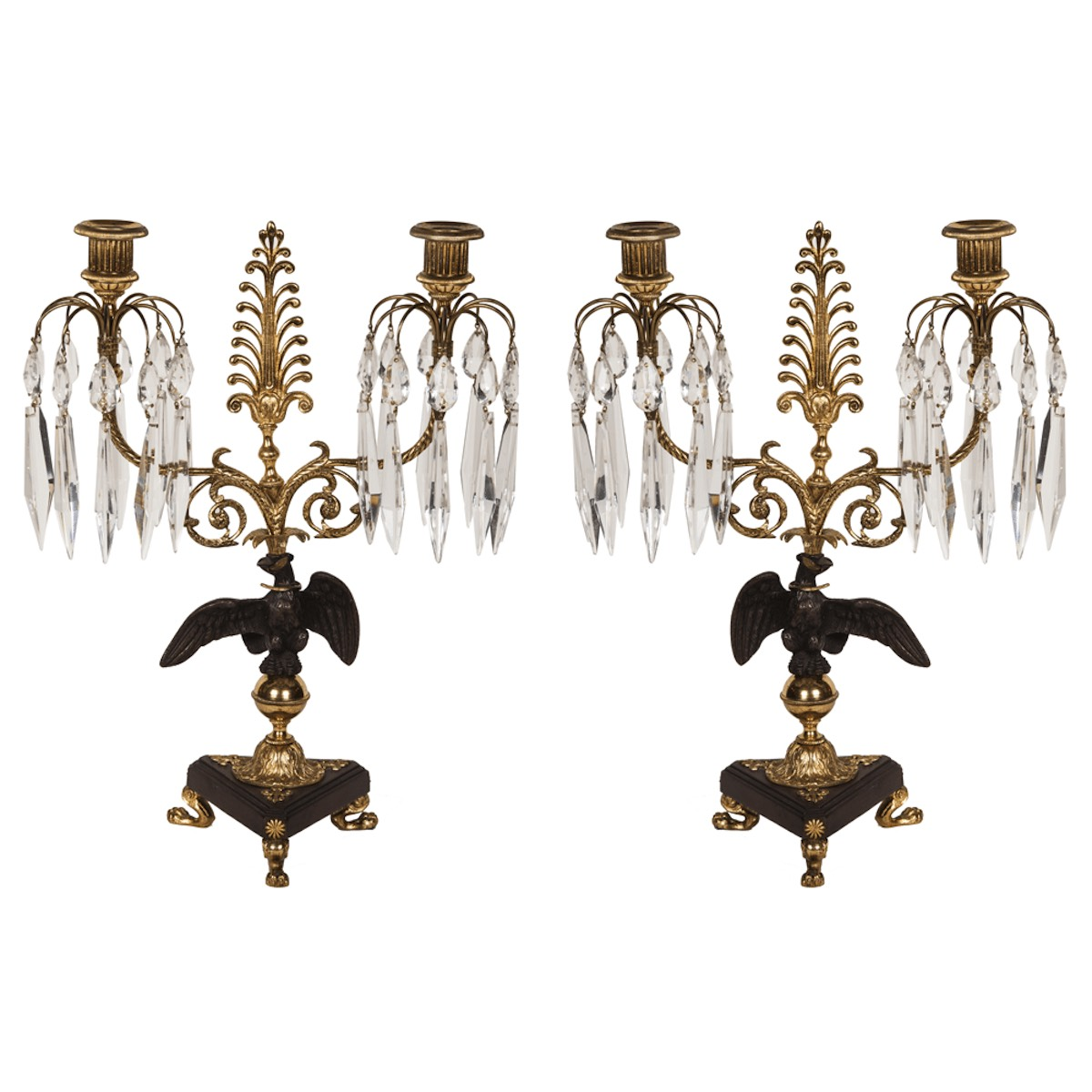 A pair of 1920's Ormolu and bronze Candelabra with Eagle and glass icicle drops