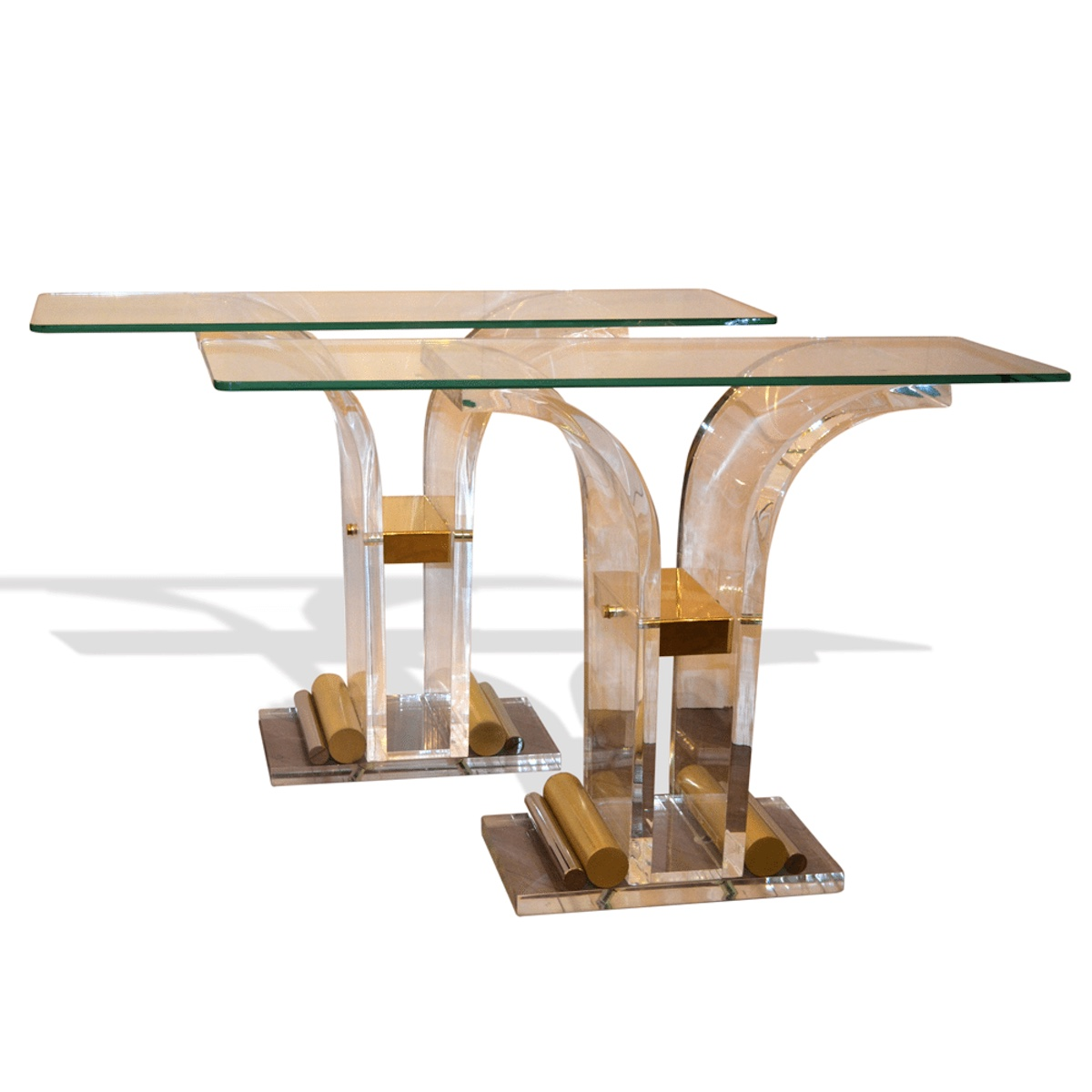 A Pair of Glass, Lucite and Brass Console Tables